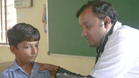 Doctor is checking child - Bhachau, Gujarat - June 2018