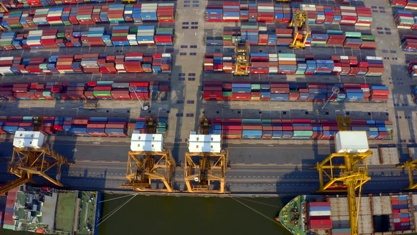 Aerial shot of pier in port of Bangkok, Thailand.Top view of container ship in export and import business and logistics. Shipping cargo to harbor by crane. International water transport concept. | Shutterstock HD Video #1023723364