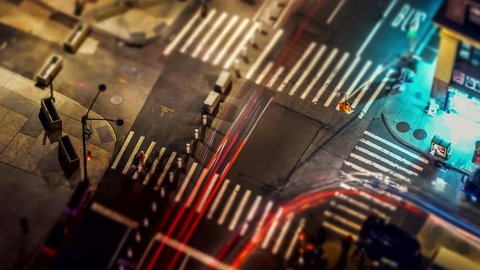 Miniature view of traffic on illuminated of a street intersection in Manhattan,NEW YORK CITY at night. 4K time lapse.