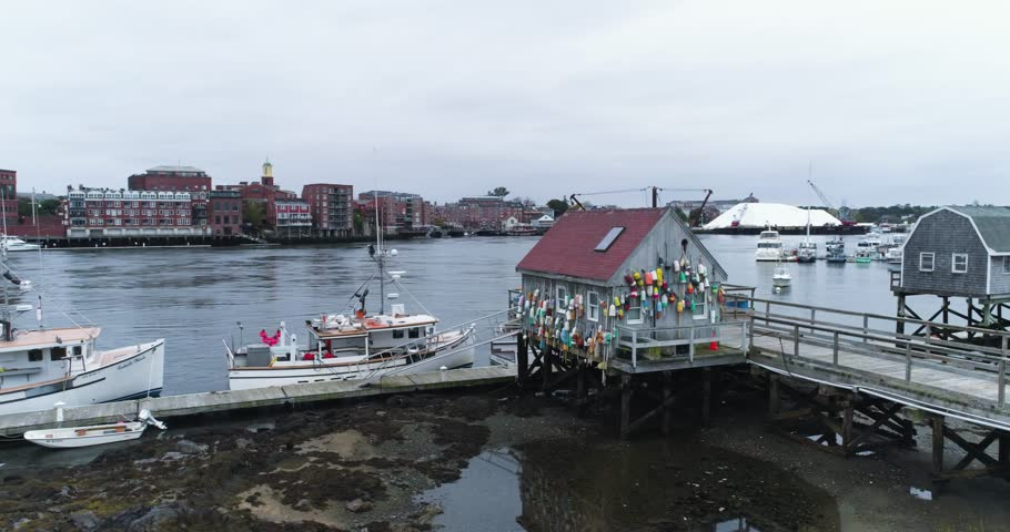 Portsmouth, New Hampshire / United States - August 21 2018: Fishing Harbor, Marker Buoys on Wall, Boats Docked