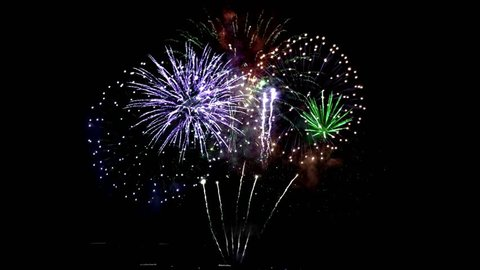 Colorful fireworks. Beautiful celebration backgraund.  Fireworks in 4k seamless loop at night sky isolated.