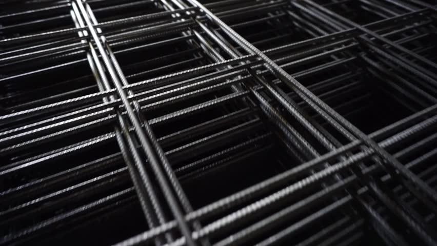 Construction iron background. Reinforcement Mesh building material  | Shutterstock HD Video #1023815644