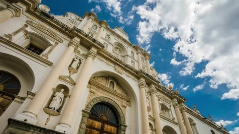 A timelapse of the facade of the Antigua Guatemala Cathedral in with a cloudy sky.