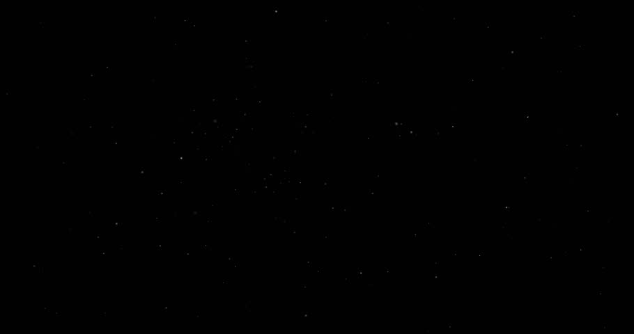 Flying dust particles on a black background | Shutterstock HD Video #1023884134