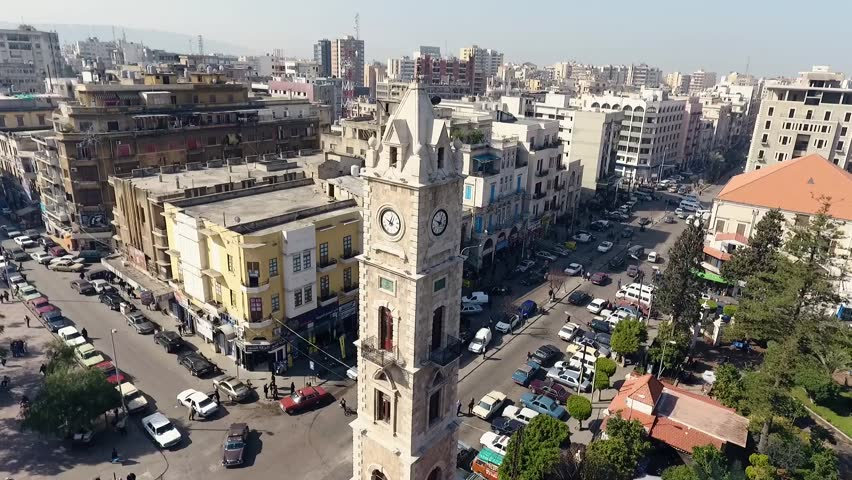 Aerial Shot for El-Tall Clock Tower, Tripoli-Lebanon  showing traditional and historical  Streets built in 1906s | Shutterstock HD Video #1023884374