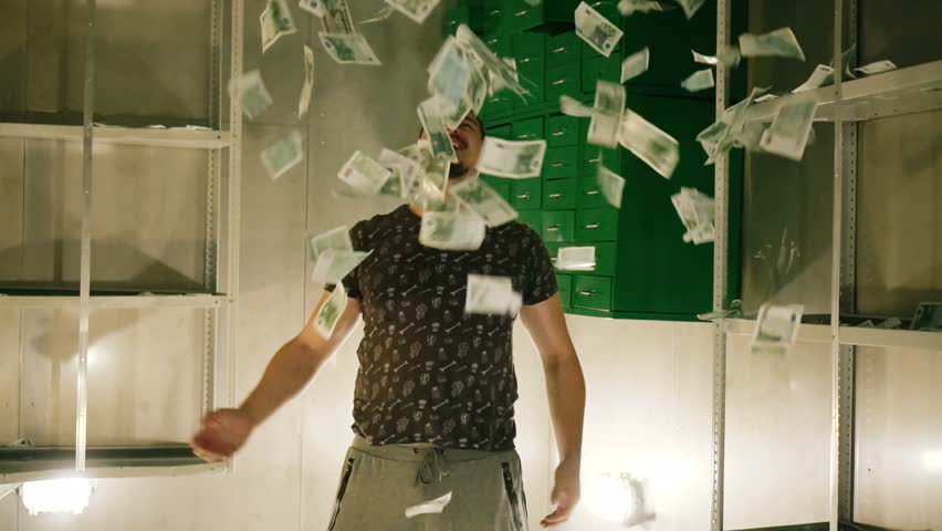 Guy slowmotion throws lot of money banknotes. Many dollars fly in air above your head in slowmo. happy person rejoices in great wealth of money. Many dollars and euro are scattered in bank box America | Shutterstock HD Video #1023917854