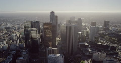 Epic helicopter wide shot point of view AERIAL view of skyscrapers in the city and surrounding neighborhood communities in downtown Los Angeles, United States