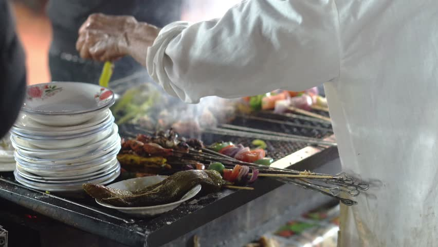 Traditional Street Food in Morcco at the Jamaa el Fna Square Market at night   Shutterstock HD Video #1024038164