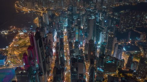 HONG KONG - MAY 2018: Aerial timelapse view of Causeway Bay, Wan Chai and Victoria Bay, residential and office buildings and skyscrapers. City from above at night.