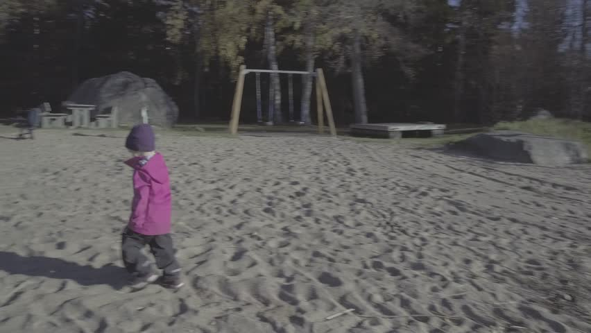 Young girl learning how to jump on one leg, trying but loosing balance | Shutterstock HD Video #1024045064