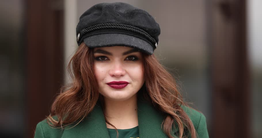 Stylish brunette girl in black beret and green coat with dragonfly brooch. | Shutterstock HD Video #1024110074