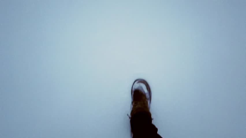 The person in the boots walks through the snow and reaches the ice-hole,  and check it for strength with a foot , first-person view | Shutterstock HD Video #1024119104