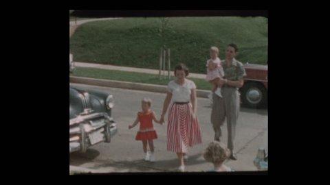Baltimore, Maryland, USA- 1956: Neighbors and antique cars suburban street