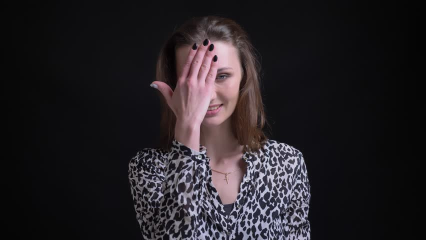 Closeup portrait of adult caucasian female clapping her head with hand in regret and remorse in front of the camera | Shutterstock HD Video #1024149164