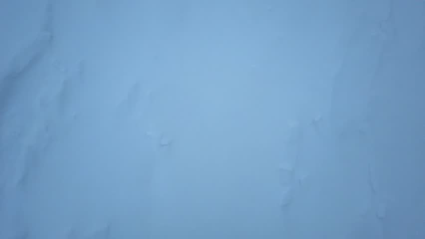 Feet in boots walking on a snowy ground first person view in the evening | Shutterstock HD Video #1024164704