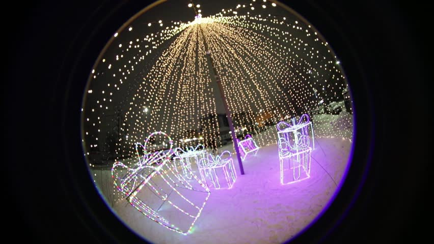 Festive Christmas illuminations at night in the park. optical effect Circular fisheye | Shutterstock HD Video #1024165334