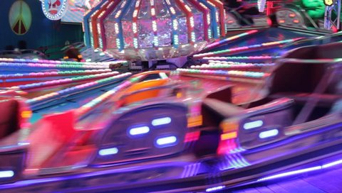 disco lights funfair fairground ride synthwave retrowave rainbow bokeh lights rides moving flashing people at night