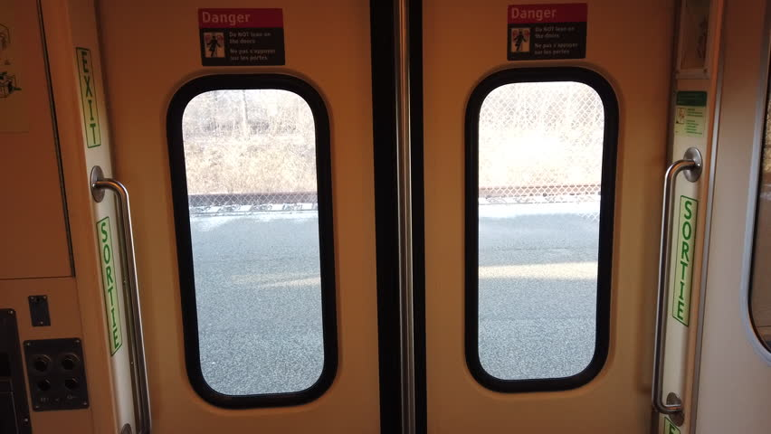 Train doors opening from the inside and person exiting train.  | Shutterstock HD Video #1024166864