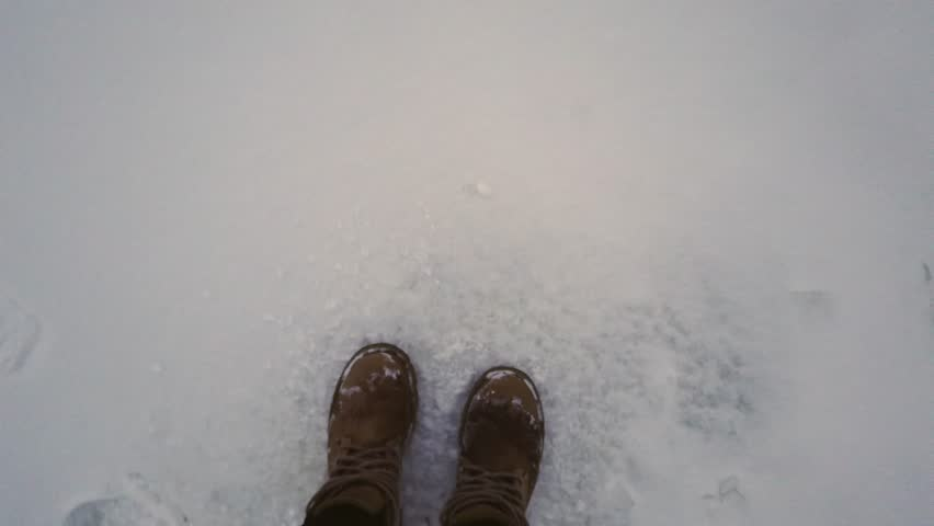 First-person view of the feet running away in the snow from pursuit, sometimes turning back | Shutterstock HD Video #1024195544