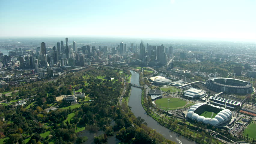An aerial approach shot towards Melbourne city from south along Yarra River