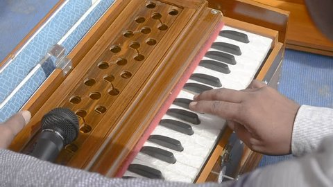 Young Indian playing harmonium 2