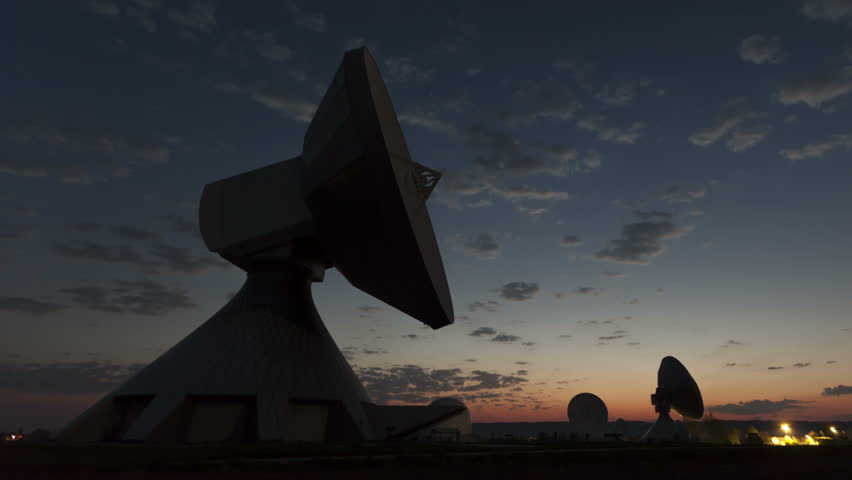 4K Time lapse close up Parabolic satellite dish sunrise at the earth radio station in Raisting