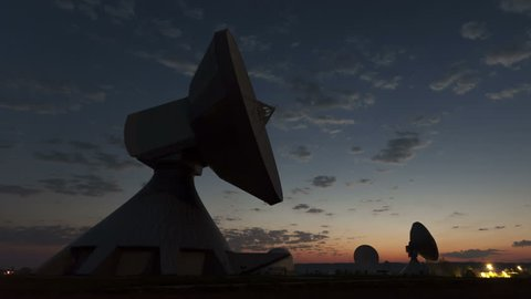 4K Time lapse close up Parabolic satellite dish sunrise at the earth radio station in Raisting