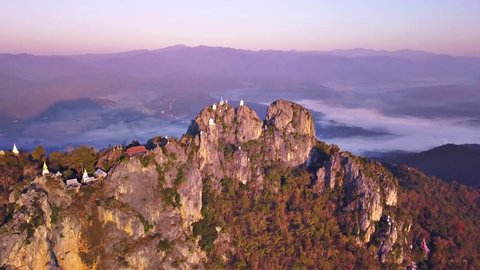 Aerial view of pagodas and temple  on a high mountain peak, Wat Prajomklao Rachanusorn (Wat Phrabat Pu Pha Daeng),Lampang province,Thailand
