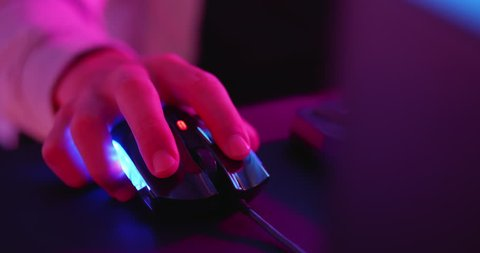 close up of cyber sport gamer play game and click the mouse