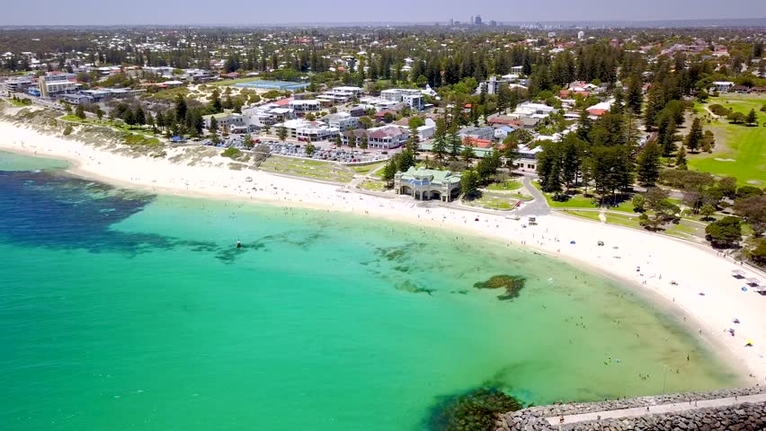 Summer day at Cottesloe Beach and the Indiana Tea House in Perth, Western Australia, Australia. Perth coastal aerial (drone) video footage.