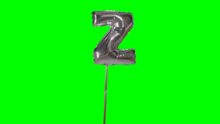 Letter Z from alphabet helium silver balloon floating on green screen