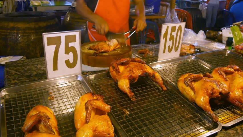 Thai street food. BBQ grill on the fire .