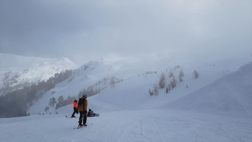 Skiers go on mountain slope downwards - Video HD #1024411664