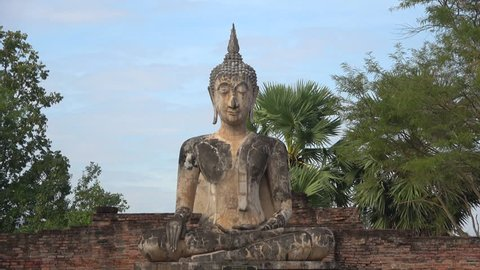 SUKHOTHAI, THAILAND - DECEMBER 24, 2018: Sculpture of a seated Buddha at the ruins of a Buddhist temple Wat Mae Chon