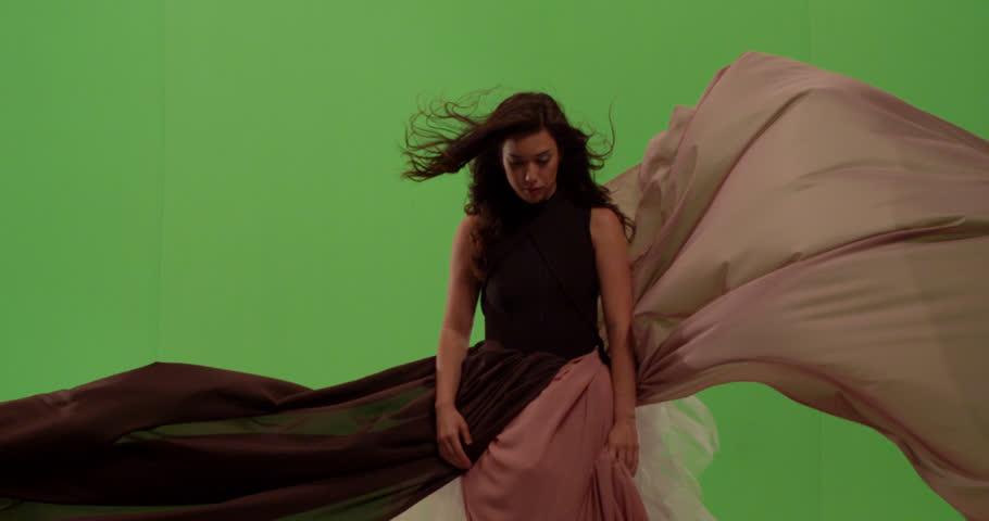 Beautiful mixed race asian white woman fashion model dancer posing against green screen | Shutterstock HD Video #1024441124