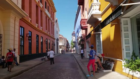 CARTAGENA, COLOMBIA - NOVEMBER 2018: Walking on the touristic streets of Cartagena with smooth slow motion flow