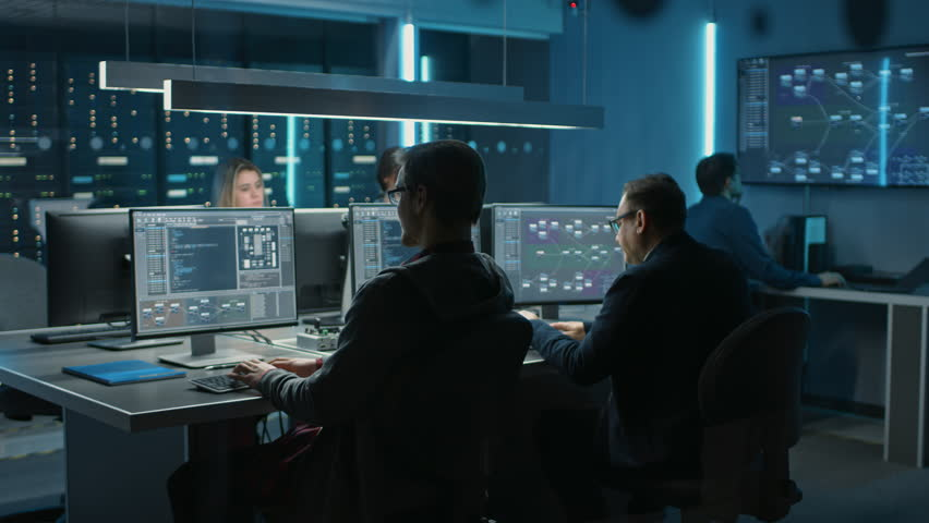 Team of IT Programers Working on Desktop Computers in Data Center Control Room. Team of Young Professionals Working In Software and Hardware Development, Doing Coding | Shutterstock HD Video #1024519664