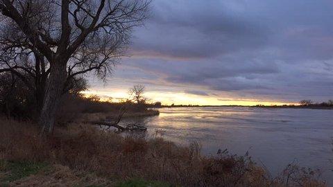 KEARNEY, NEBRASKA - CIRCA 2018 - Establishing shot of the Platte River in golden light in central Nebraska near Kearney.