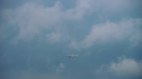 CHANGI, SINGAPORE - NOVEMBER 25, 2018 : Singapore Airlines Airbus A330 approaching in clouds and fog plume before landing in Changi Airport, Singapore