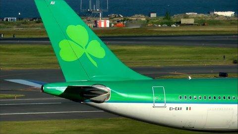 Aer Lingus airline logo airplane tail, Logan Airport Boston Massachusetts USA, September 19, 2013