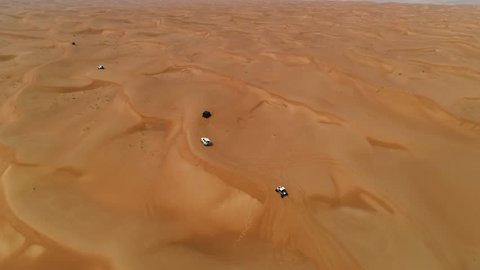 Aerial view group of car driving on a deserted landscape, U.A.E.