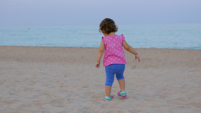 Small baby girl on the beach | Shutterstock HD Video #1024698944