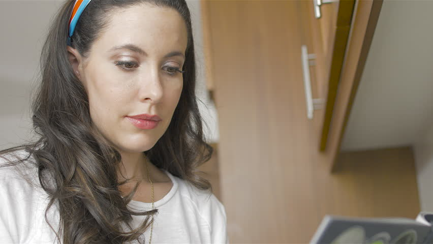 Beautiful brunette preparing a green juice withe vegetables   Shutterstock HD Video #1024707074
