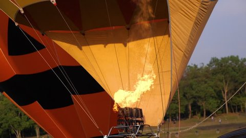 Close up slow motion of propane gas fire burner in hot air balloon for take off at Chiangrai, Thailand