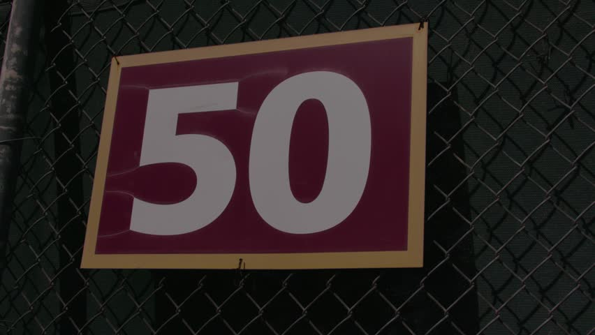 Red 50 sign on a metal fence. | Shutterstock HD Video #1024762874