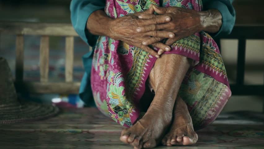 Feet of older asian women in home
