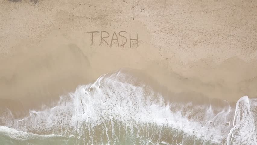 TRASH - inscription on the sand. Ecological massage/Statment. Aerial art form. Drawing Calligraphy on the beach/ sand. Nature Manifesto. Info- ecosystem. Symbol of planet degradation. HELP screaming | Shutterstock HD Video #1024872494