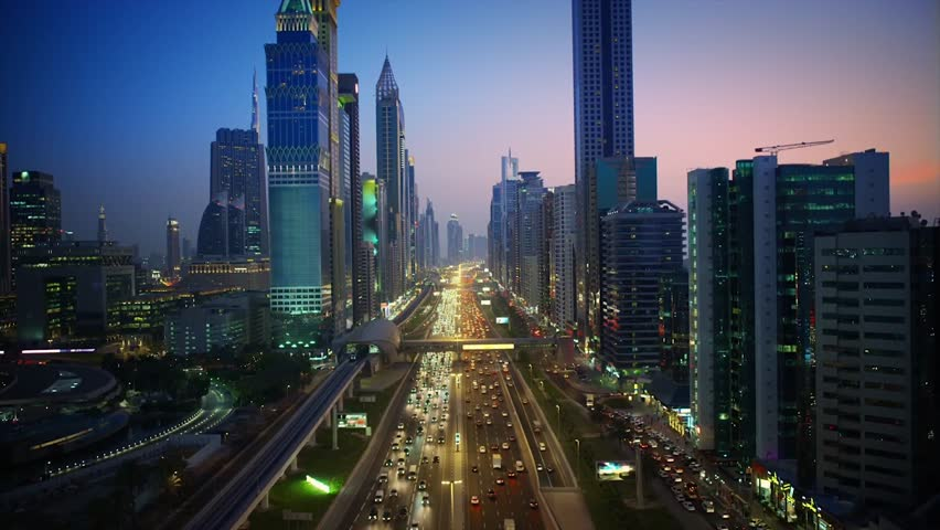 Magnificent downtown Dubai modern architecture highway in pink evening sunset night illumination on 4k aerial ciytscape #1024898054