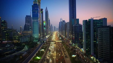 Magnificent downtown Dubai modern architecture highway in pink evening sunset night illumination on 4k aerial ciytscape