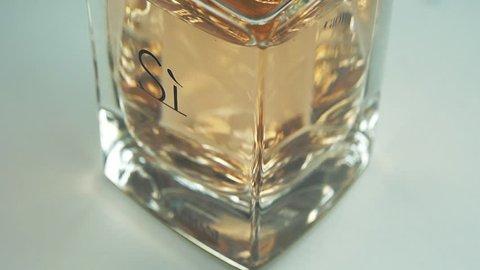 Melaka, Malaysia - Circa March, 2019: Emporio Armani Si perfume bottle. Rotating close-up footage.